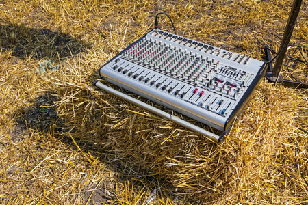 soundboard: Sound board stacked on straw bale at harvest time.