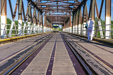 vanishing point: Combined bridge for the transport railroad and road vehicles, vanishing point perspective.