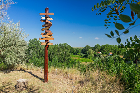 bidirectional: Old wooden road signs with many left and right arrows. Stock Photo