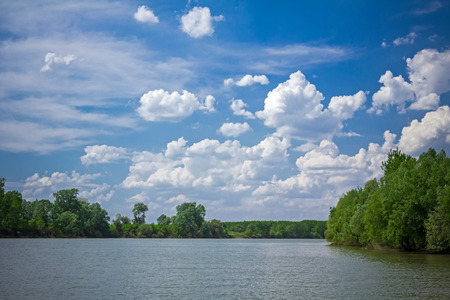 other side of: Other side of the river landscape with cloudscape. Stock Photo