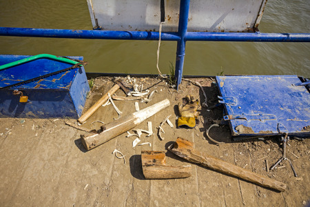 Making new tool for manually pulling ferry boat from wood.