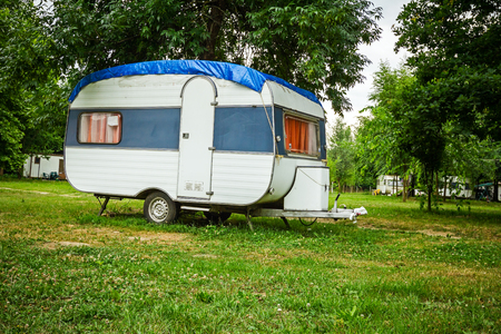 Travel trailer camping is parked at the camping site.