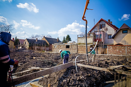 concreting: Team of construction workers are working on concreting. Stock Photo