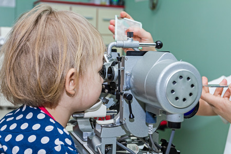 nearsighted: Girl undergoing eye is at examination in clinic with special equipment.
