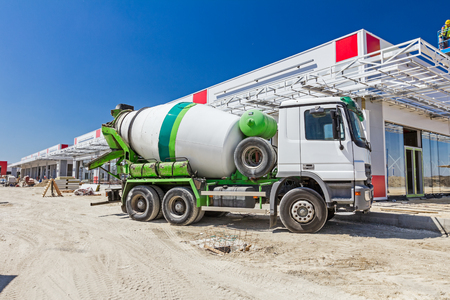 cement: Mixer truck is transport cement to the casting place on building site.