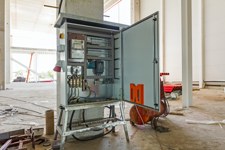 providing: Electrical cabinet with connectors is providing electrical energy to construction site. Stock Photo