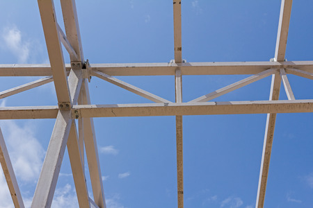 girders: New structure girders on skeleton of the future roof against the blue sky. Stock Photo