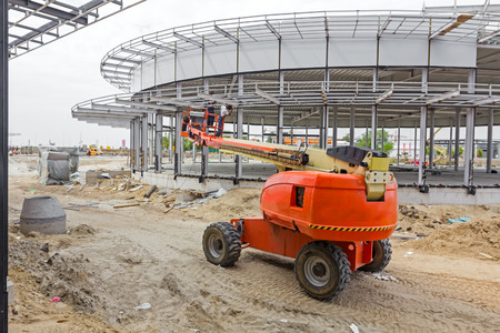 High elevated cherry picker with team of workers on construction site. Stok Fotoğraf