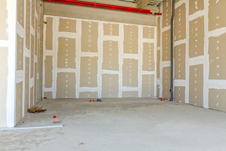 Front view of gypsum wall with joints at building site Standard-Bild