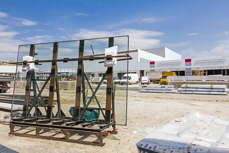 industry background: Pallet with Thermo window glasses in construction site waiting for built in.
