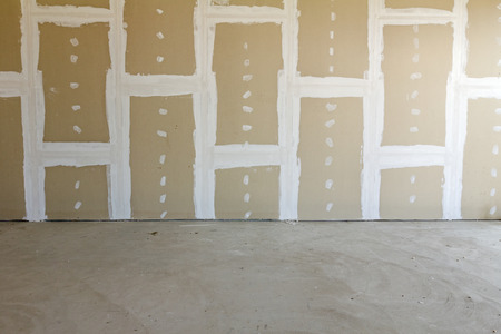 Front view of gypsum wall with joints at building site Stok Fotoğraf