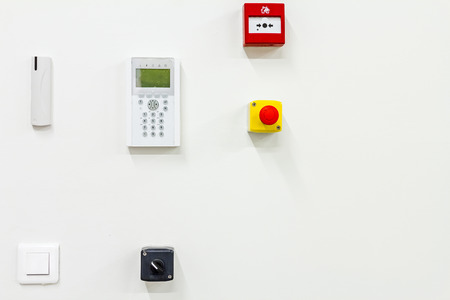 stop button: Wall has attached control buttons, fire alarm, stop button, wireless control keyboard.