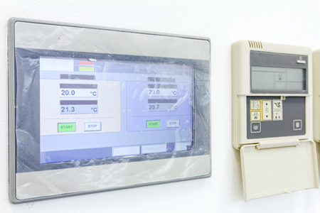 programmable: Smart home automation: wall display showing household consumptions related to temperature and heating. Stock Photo