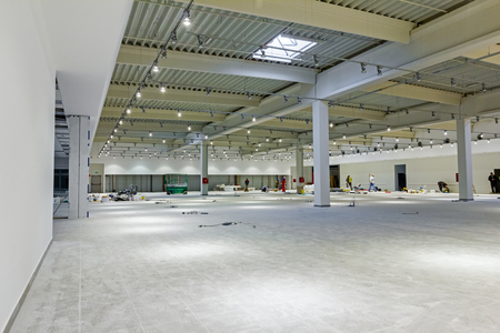 Interior of empty unfinished modern mega market. Architecture concept.