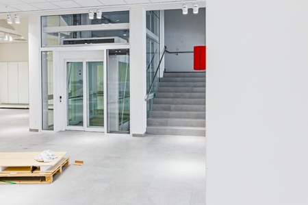 View on staircase and glass elevator in a modern business centre.