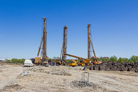 View on construction site with big equipment for drilling into the ground.