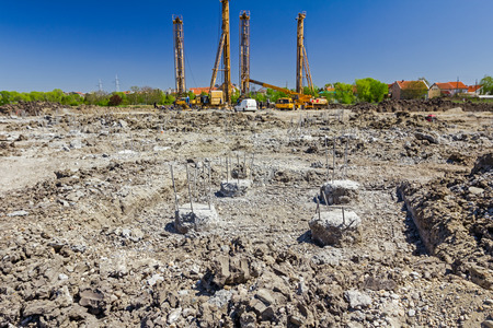 cornerstone: View on construction site with big equipment for drilling into the ground.