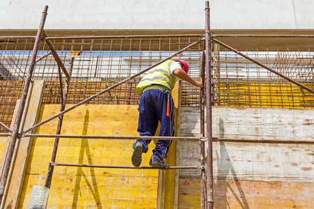 concreting: View on building site until workers are assembly a huge mold with reinforcement mesh for concreting. Stock Photo