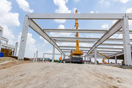 joist: Mobile crane is carry concrete joist to assembly huge hall. Stock Photo