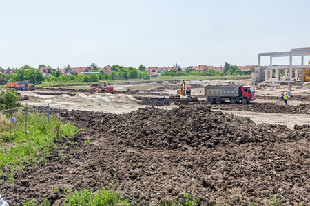 rock wool: Landscape transform into urban area with machinery, people are working. View on construction site.