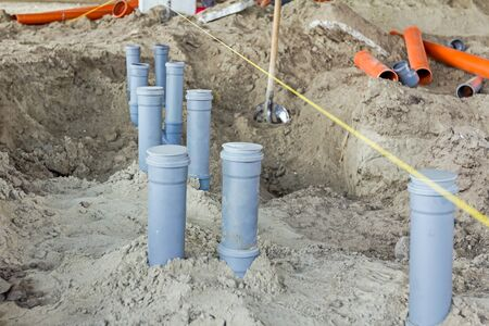 lined up: Set of waste pipes are assembled and lined up on building site. Stock Photo