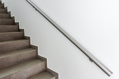 emergency stair: Stairway with metallic banister in a new modern building. Every building is required to have emergency stairways as safety measure.