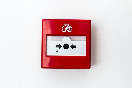 undone: Red fire alarm panel box is on the wall, to smash glass and press button. Every building is required to have a fire alarm. Stock Photo