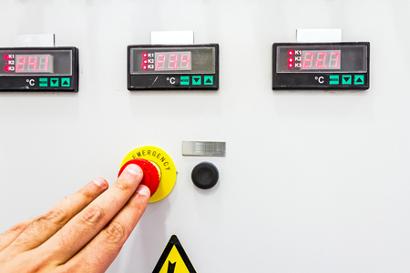 override: Activation or shutdown fuse box, with display for digital temperature gauge with warning sticker and an emergency shutdown (panic) button. Stock Photo