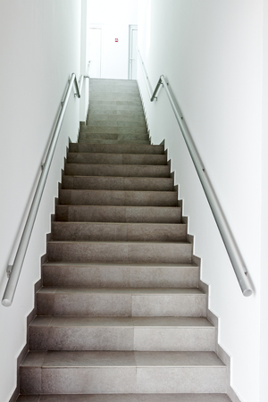 going places: Stairway with metallic banister in a new modern building. Every building is required to have emergency stairways as safety measure.