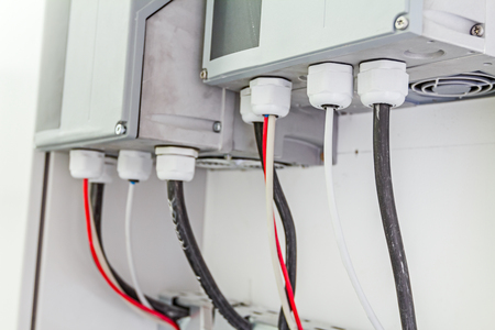 electric line: Electrical cabinet with connectors is providing electrical energy to residential place.