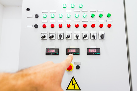 override: Hand is showing on electrical control panel which contains a digital display for temperature check