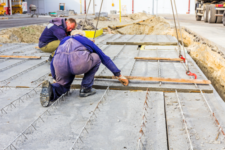 set up: Workers are set up concrete slab to assembly underground edifice.