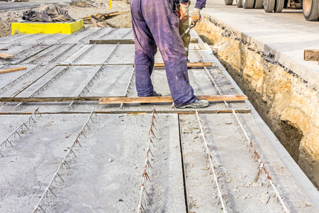 edifice: Workers are set up concrete slab to assembly underground edifice.