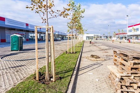 ending: Zrenjanin, Vojvodina, Serbia - 09. October 2015: Garden Worker is cleaning new parking place, ending works at shopping mall AVIV PARK