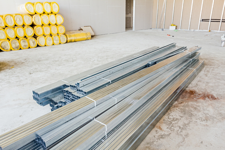 bulkhead: Pile of metallic profiles for plasterboard or dividing wall. Stock Photo