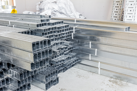 plasterboard: Pile of metallic profiles for plasterboard or dividing wall. Stock Photo