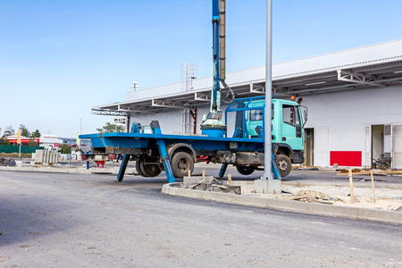 stability: Truck with elevated bucket has lateral stabilizer extended to make better stability.