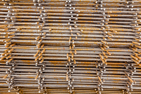 cusp: Spikes of rebar grid, reinforcing mesh, steel bars stacked for construction. Stock Photo