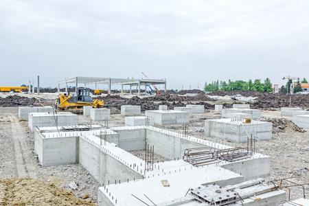 edifice: Concrete base of new edifice with reinforcement at building site is ready for next step.