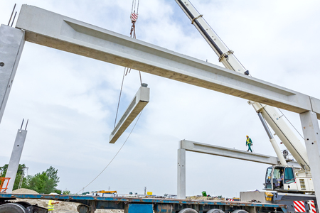assembly hall: Mobile crane is carry concrete joist to assembly huge hall. Stock Photo