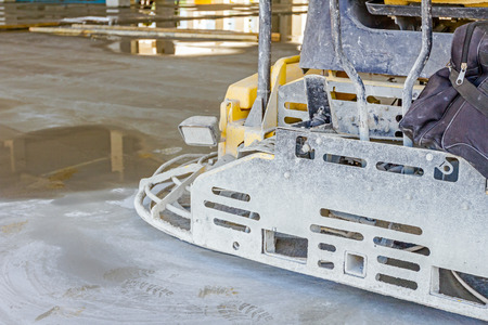 self operation: Detail of self leveling power trowel machine, sander, for smoothing surface on concrete slab. Stock Photo
