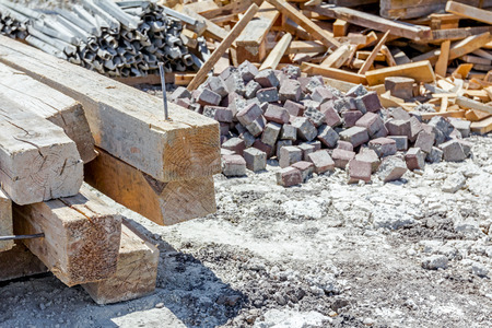 stockpile: Various type of goods for different usage are selected and piled construction site in the improvised warehouse, stockpile.