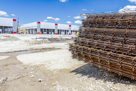 Spikes of rebar grid, reinforcing mesh, steel bars stacked for construction. Stock Photo