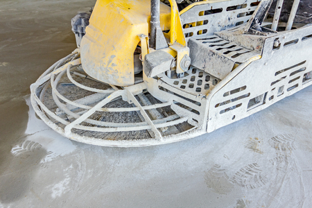 sander: Detail of self leveling power trowel machine, sander, for smoothing surface on concrete slab. Stock Photo