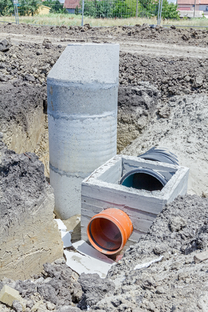 sewer water: Assembly process concrete reinforcement housing for drainage waste water from resident, sanitary sewer system. Landscape transform into large urban area. Stock Photo