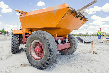 mini loader: Little construction dumper carrier is at building site. Stock Photo