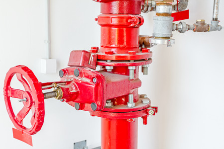 Master valve for water supply, fire fighting system control and pipeline is painted in red.