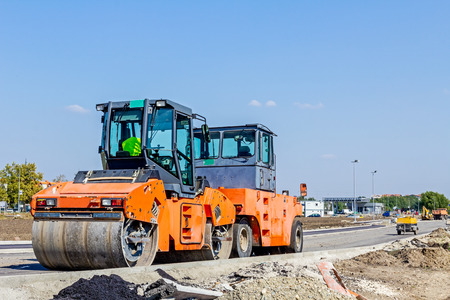 blacktop: Group of machines for spreading asphalt are parked after road construction at building site. Stock Photo