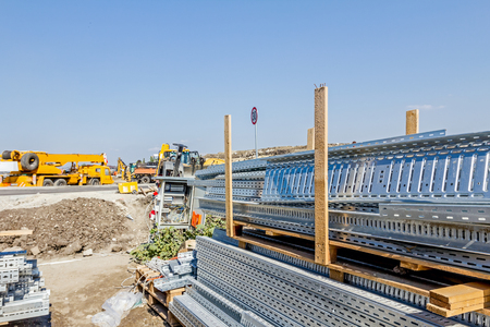 Cable trays for different usage at construction site in the improvised warehouse. Stock Photo