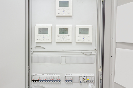 radio unit: Smart home automation: display showing household consumptions related to temperature and heating. Automatic fuse electrical connector in power lines located inside of switch control panel board.